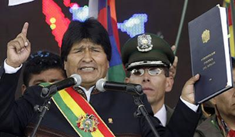 Bolivian President Evo Morales with constitution